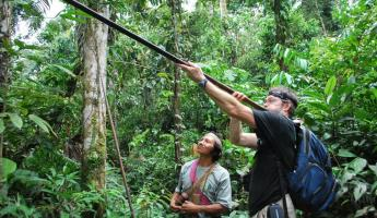 Learning to shoot a blow dart at Huaorani Lodge