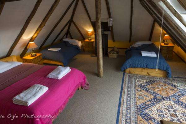 Snuggle up in thie triple room at Haceinda El Porvenir