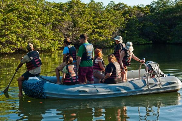Travelers take a zodiac through the waters of the Galapagos.