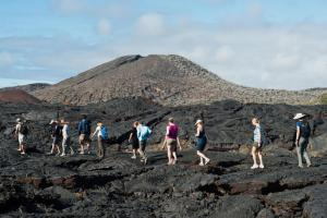 Hiking across volcanic rock.