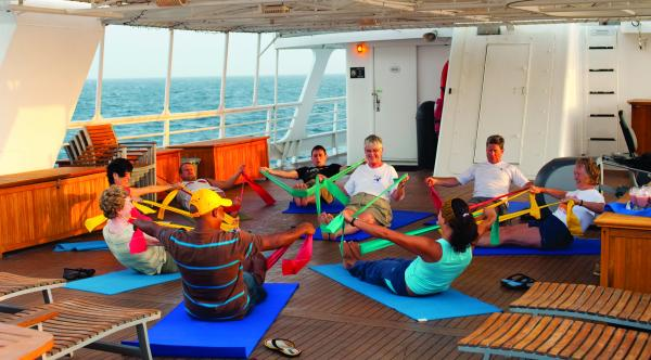 Guests exercising on the deck of the Sea Bird & Sea Lion.