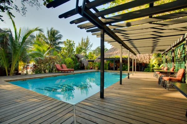 Enjoy the pool at Singing Sands Resort after a day of exploring Belize