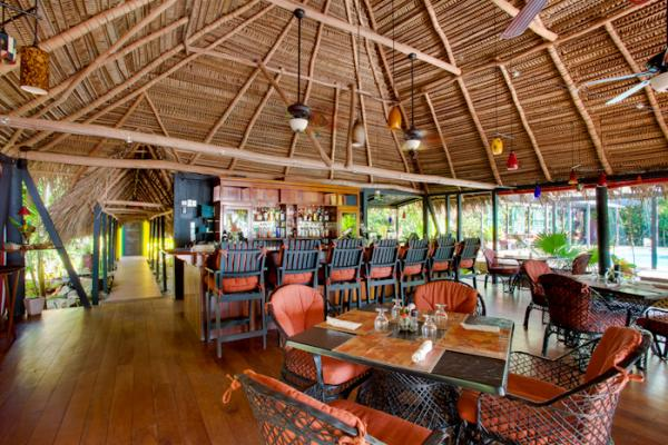 Relax in the dining room at Singing Sands Resort on your Belize tour