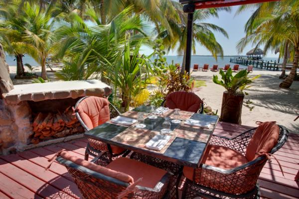 Enjoy fine dining on the patio at Singing Sands Resort