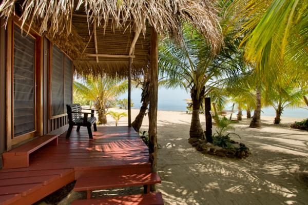 Your cabana opens to the beach at Singing Sands Resort