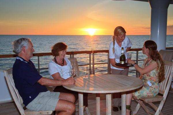 Enjoying a drink on the deck of the Oceanic Discoverer.