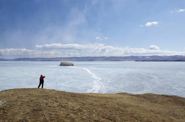 Traveler photographing a rift lake in Russia.