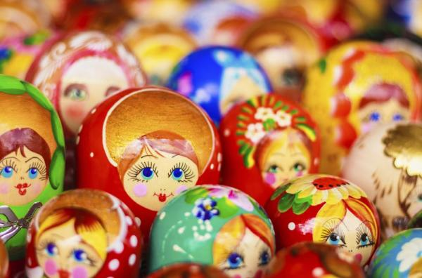 A cluster of multicolored matryoshka dolls.