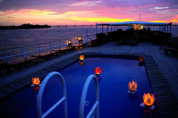 Watch a beautiful sunset in the Road to Mandalay's luxury pool.