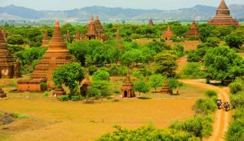 Temples cover the green landscape of Burma.