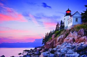 A beautiful lighthouse at sunset.