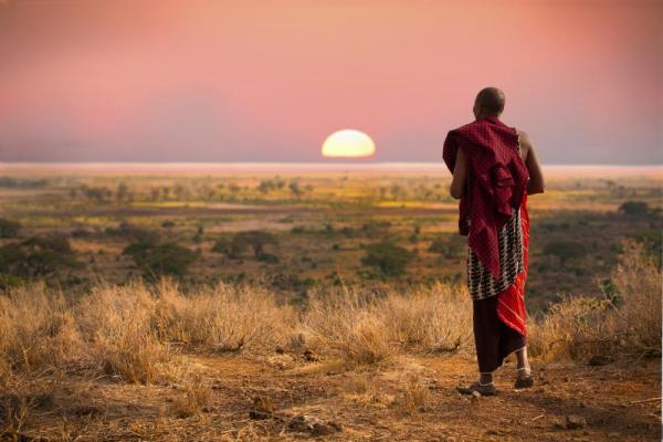 A local of Africa walking into the sunset.
