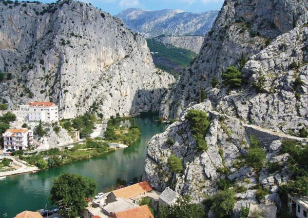 Explore the rugged coastline of Omis on your bike and cruise tour around Croatia