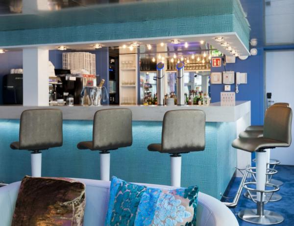 Unwind at the bar on the MS Cyrano de Bergerac