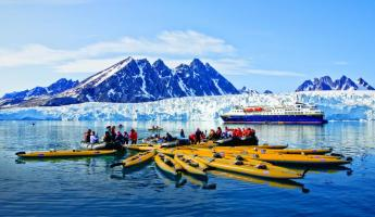 Taking a kayaking trip around Monaco Glacier on Spitsbergen Island.