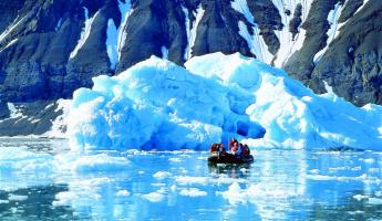 Taking a zodiac tour to see icebergs in the arctic.