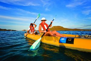Kayaking through the beautiful tropical waters.