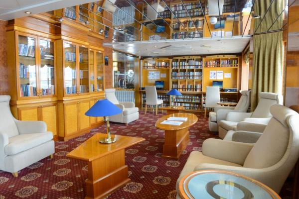 Enjoy a book in the library aboard the Sea Explorer.