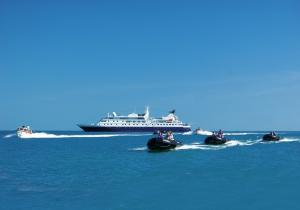 Travel by Zodiac to land on exotic shores while on your Orion cruise