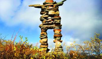 Image of an inuksuk built by the people of the North American arctic.