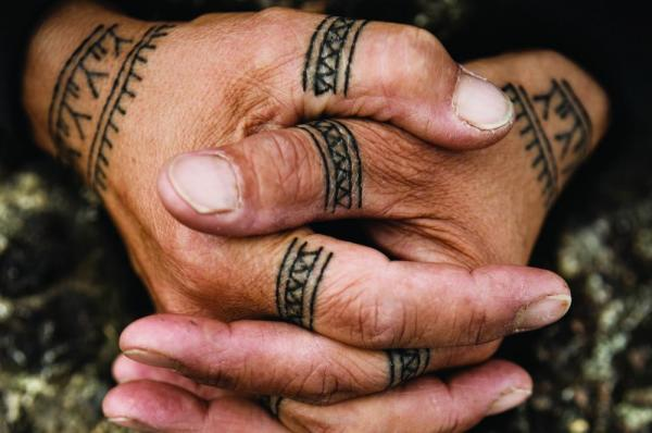 Cultural tattoos on the hands of a local.