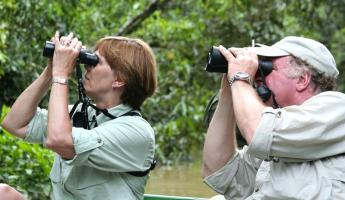 Traveler's looking at local wildlife through binoculars.