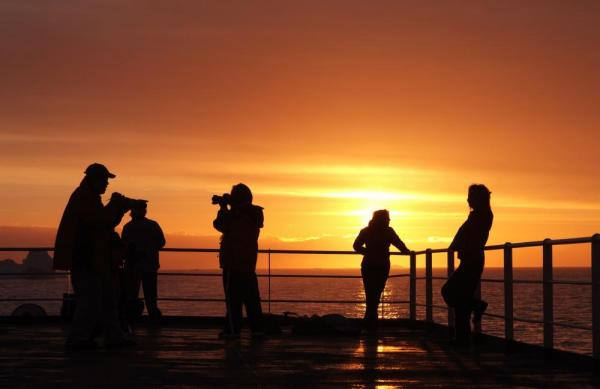 Taking pictures of the beautiful sunset from the ship.