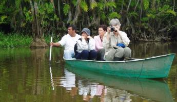 Taking a sightseeing canoe trip through the Amazon.