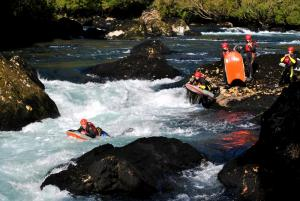 Travelers on individual rafts going down the rapids.
