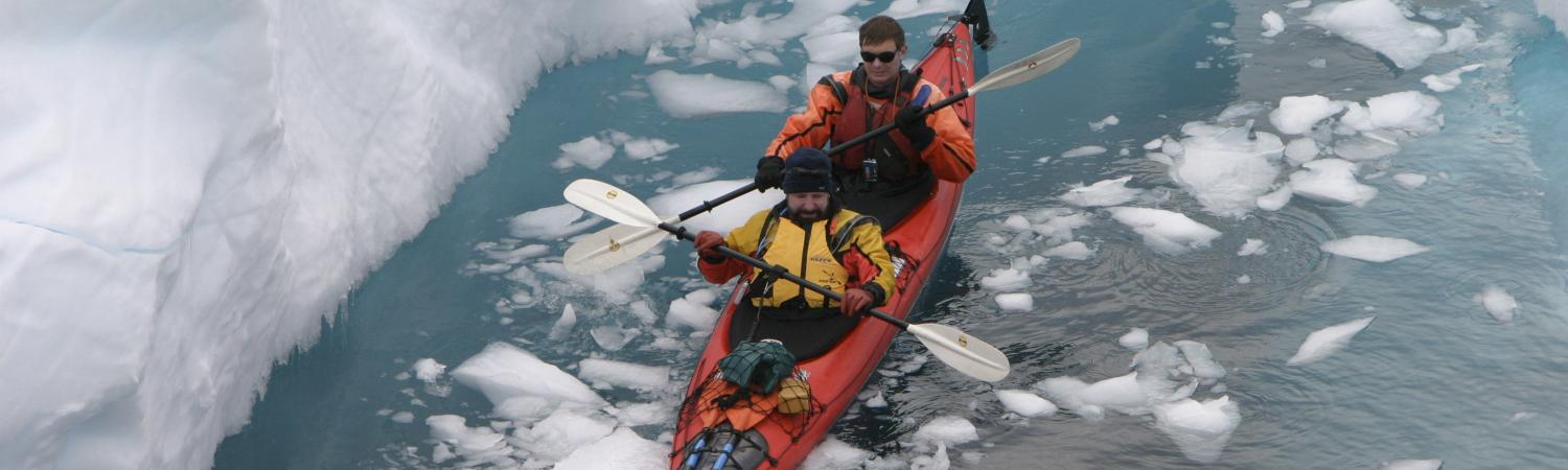 Kayaking through arctic waters.