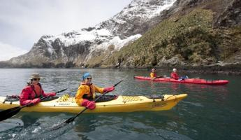 Kayakers in the waters of South Georgia.