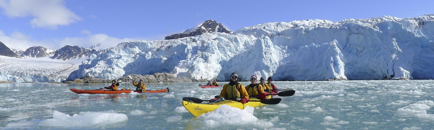 Kayaking through the arctic waters.