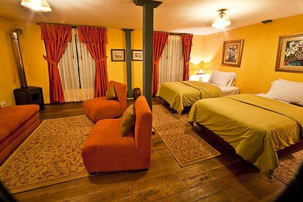 An in-room fireplace keeps this double room cozy at Hacienda El Porvenir