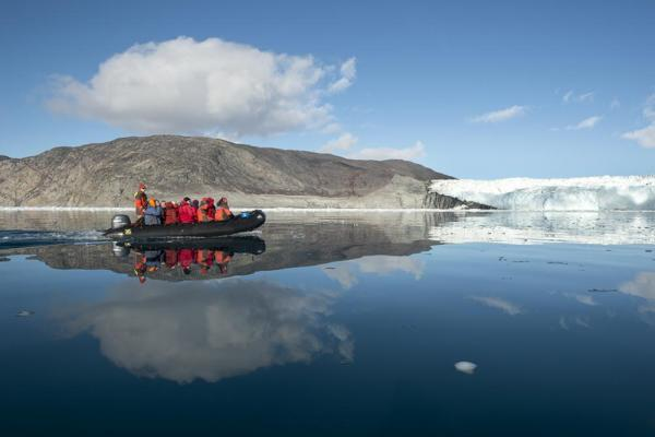 Zodiac tour to see glacier and the arctic landscape.