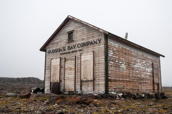 An old run down building with the Hudson's Bay Company sign on it.