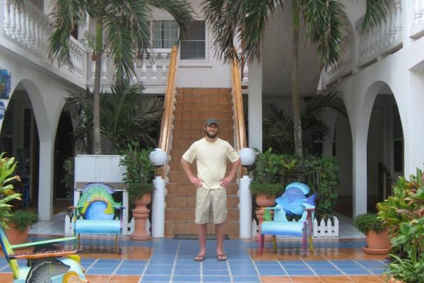 A traveler standing in Blue Tang Inn's open-air atrium
