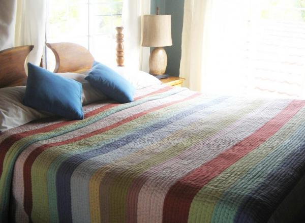 Colorful and comfortable beds at Blue Tang Inn