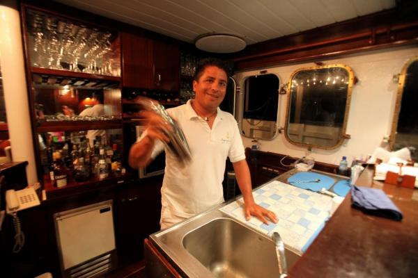 The bartender mixes a drink aboard the Mary Anne.