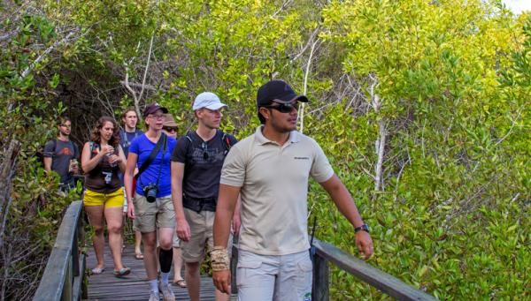 Taking a guided tour through the Galapagos.