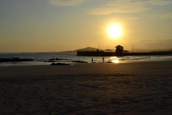 Take in a sunset on the beach at La Casa de Marita
