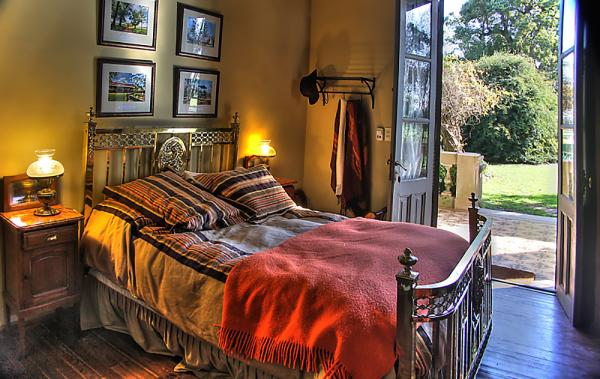 Guest rooms include large windows and an interesting array of period furniture