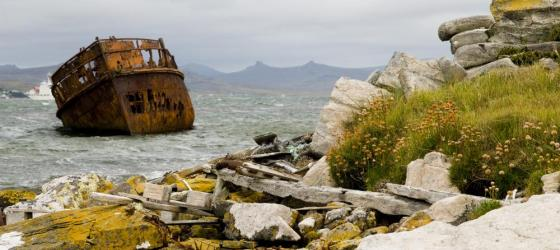 An old ship rusts in a Falkland Islands harbor