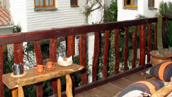 Relax and enjoy your morning coffee on the balcony.