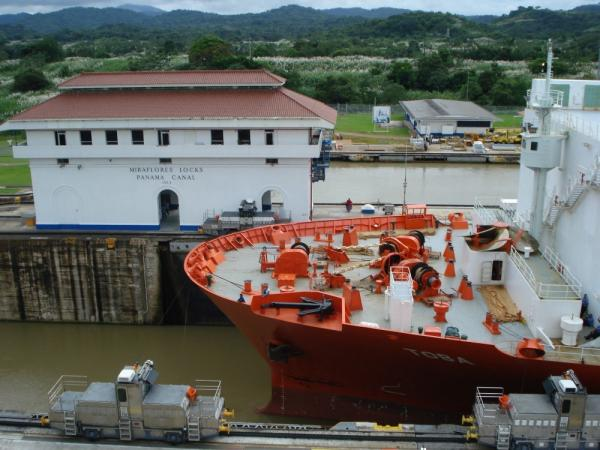 Ship being pulled through the Miraflores Locks of the Panama Canal
