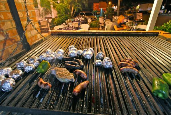 The outdoor grill of the hotel cooks some delicious food.