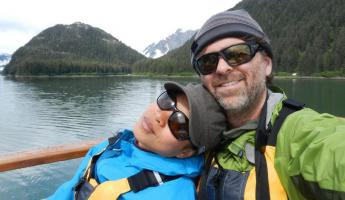 A couple enjoys their awesome adventure in Alaska
