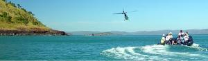 Helicopter leads a zodiac in the Southern Pacific