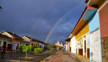 A rainbow crosses over the cathedral in Granada.