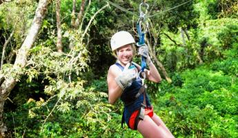 Posing for the camera while ziplining.