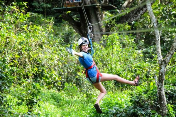 Enjoying an exciting zipline adventure.